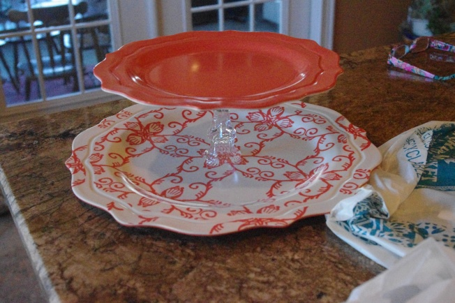 After you let the glue set for at least 5 hours. Glue the medium plate with candlestick to the center of the large plate. Then glue the small plate with candlestick to the center of the medium plate. Let it sit for at least 24 hours.