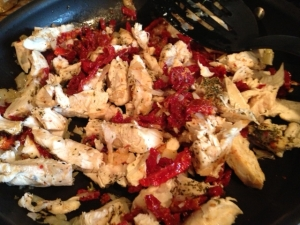 Add chicken and sun-dried tomatoes. Cook for 2 minutes.